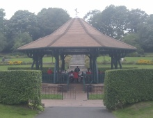 brass band performing in the park bandstand